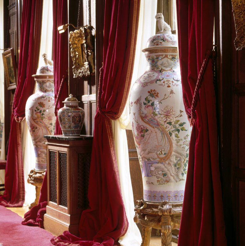 Large famille rose lidded vases in the Corridor at Polesden Lacey, Surrey.