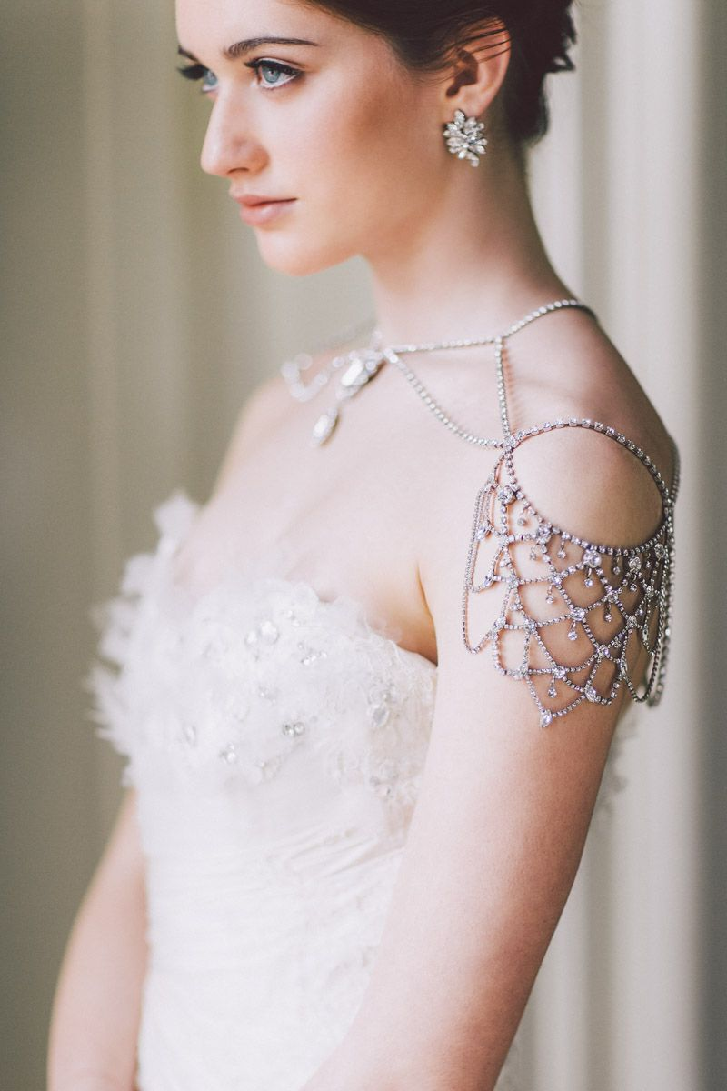 Over the shoulder bridal jewelry photography purple tree