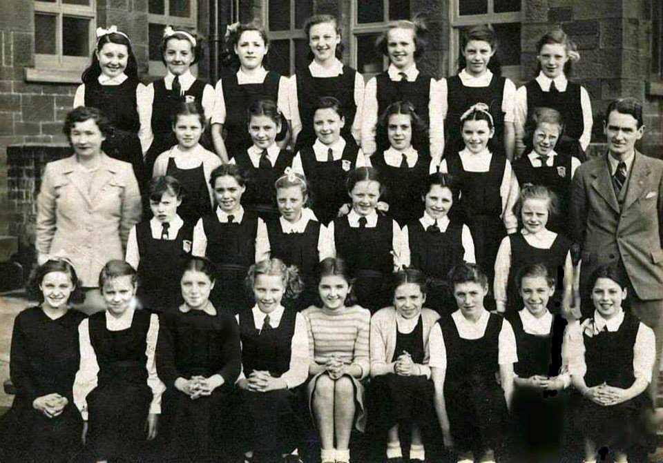 High Possil School  Teachers Miss Tynan the Maths & Mr. Duffin was the Music   Please state row & number   Back Row  1) No name 2) No name 3) No name 4) No name 5) No name 6) No name 7) No name   Third Row 1) No name 2) No name 3) No name 4) No name 5) No name 6) No name   Second Row  1) No name 2) Heather 3) No name 4) No name 5) No name 6) No name   Front Row 1) No name 2) No name 3) No name 4) No name 5) No name 6) No name 7) No name 8) No name 9) No name