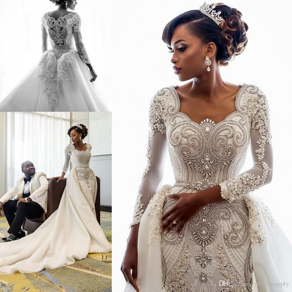 Discount 2019 Beading African Wedding Dresses Crystals Overskirts Luxury Long Sleeves Sheath Detachable Train Bridal Gowns Custom Backless Wedding Dress Expensi African Wedding Dress Sweetheart Bridal Gown Expensive Wedding Dress