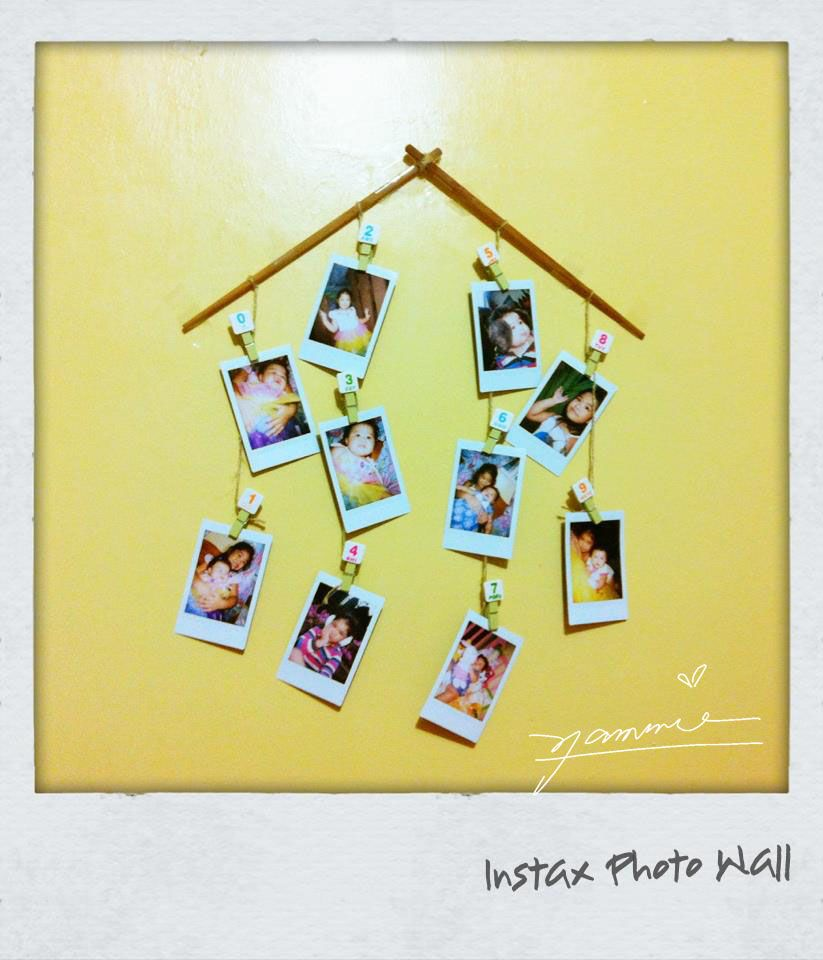 An Instax Mini, a box of Instax films, some clips and twine and a ...