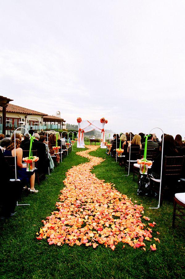orange rose petal wedding aisle photo by yvette roman photography