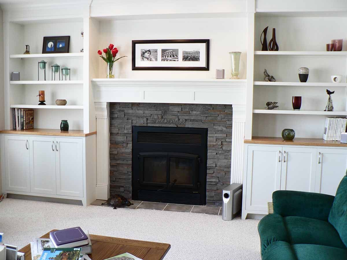 Awesome White Living Space With Black Modern Fireplace Mantel