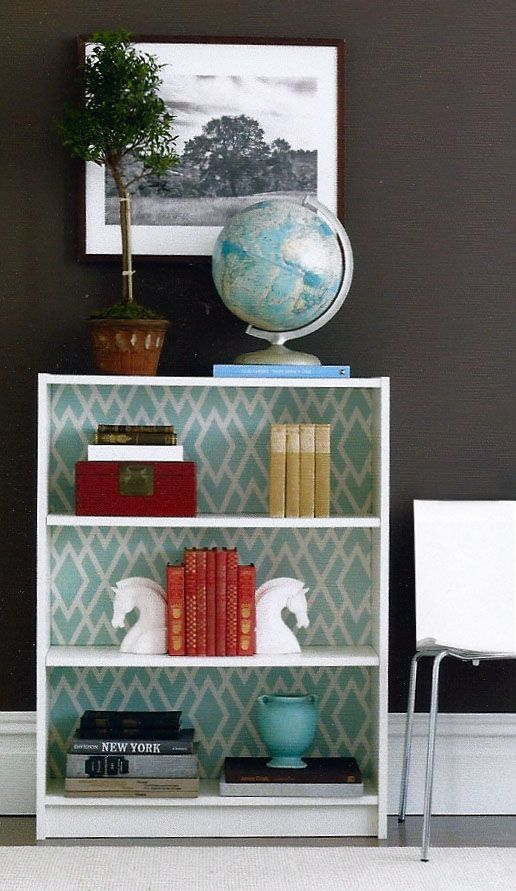 fabric covered bookcase. Great way to add color to a room in small amounts.