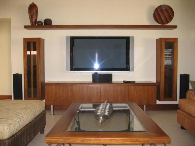 Modern slim line custom made Kiaat TV unit with CD DVD racks
