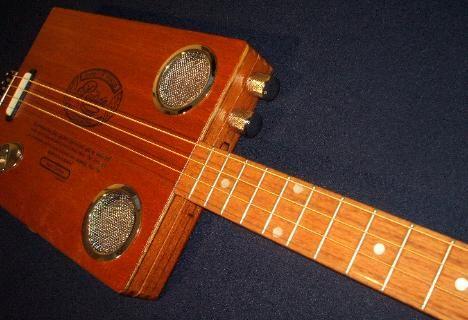 3 string guitar tenor guitars and cigar box guitars for sale 3 4 string cigar box guitars. Black Bedroom Furniture Sets. Home Design Ideas