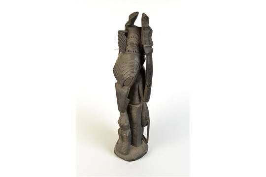 Lot 230 - THE SHEILA ROSENBERG COLLECTION  A Papua New Guinea carved figure, height 58cm.