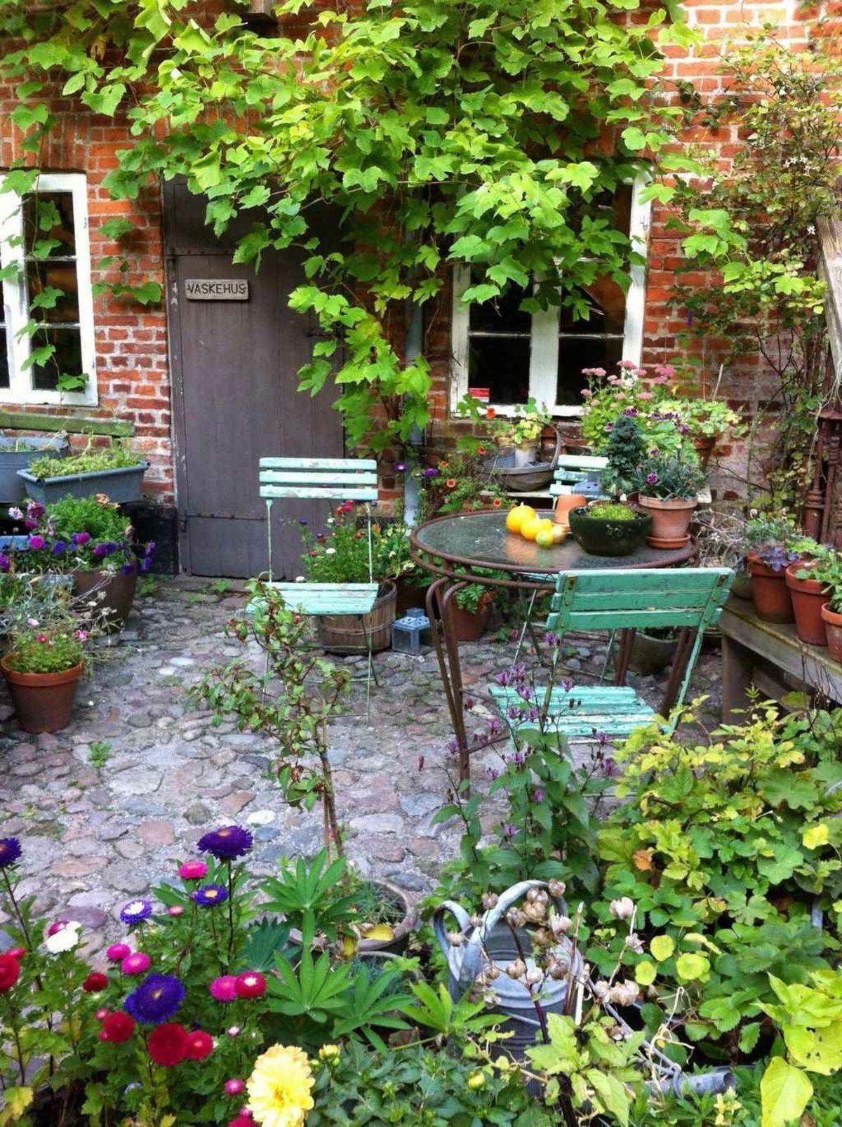 Small Terrace With Stone Flooring And Small Seating Area Small Terra Area Floori Small Cottage Garden Ideas Cottage Garden Design Backyard Garden Design