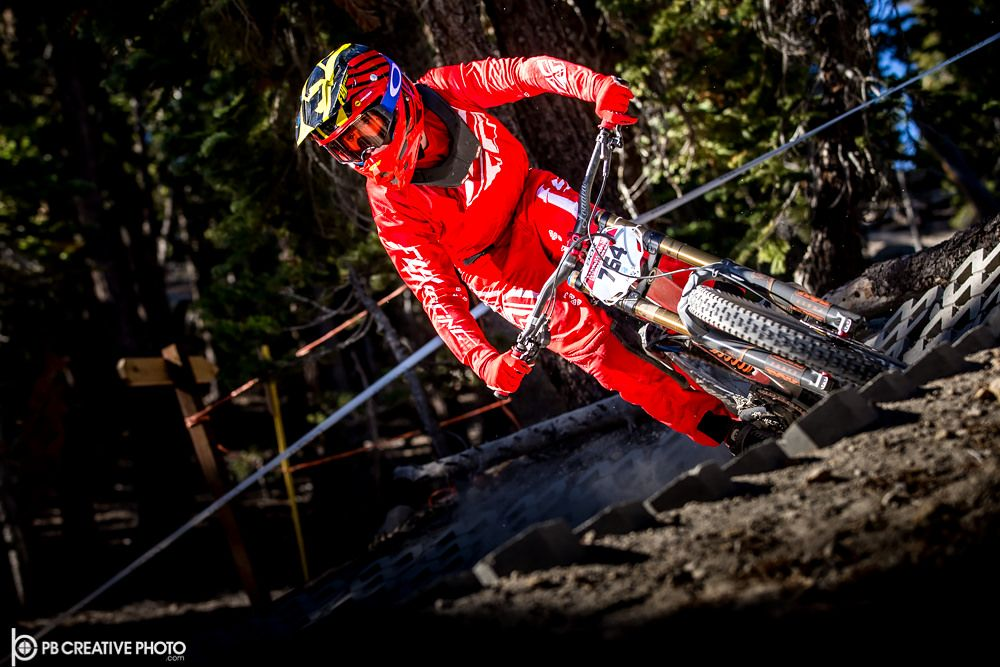 https://flic.kr/p/QRjLZ1 | Red Rover | A competitor emerges from the treeline at the 2016 Kamikaze Bike Games in Mammoth Lakes, CA.  Galleries: www.pbcreativephoto.com  Strobist: Dual Canon 600 EX RT guns on stand camera left (opposite side of trail), triggered with Canon wireless remote.
