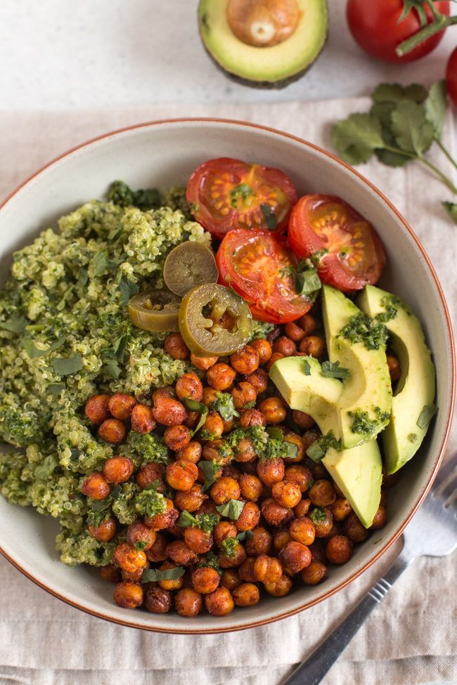 and roasted chickpea vegan burrito bowls - the perfect vegetarian Mexican food! Fluffy quinoa with coriander (cilantro) pesto, crispy roasted chickpeas and lots of fresh toppings.