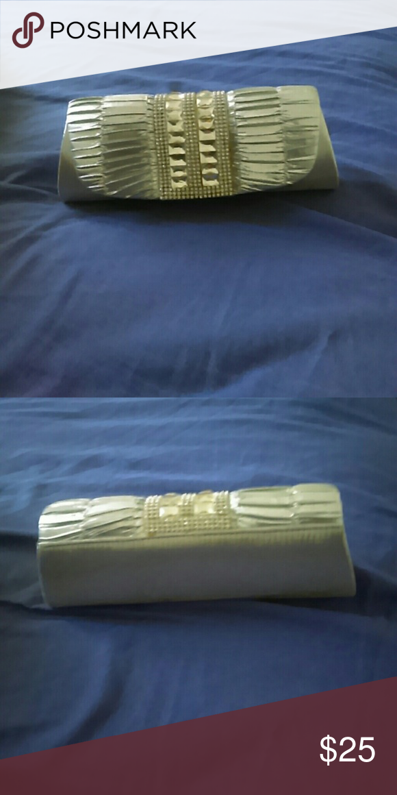 Silver Clutch Silver clutch W/ gemstones going down the middle & an adjustable chain inside. Bags Clutches & Wristlets