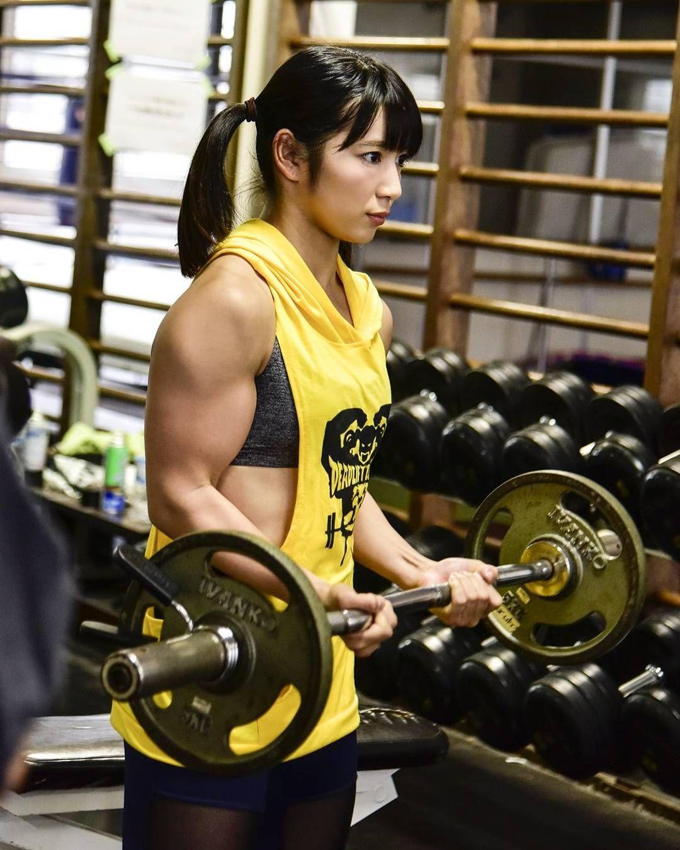 Asian strong girl do exercises on stock photo