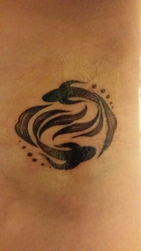 Photo of Pisces tattoo