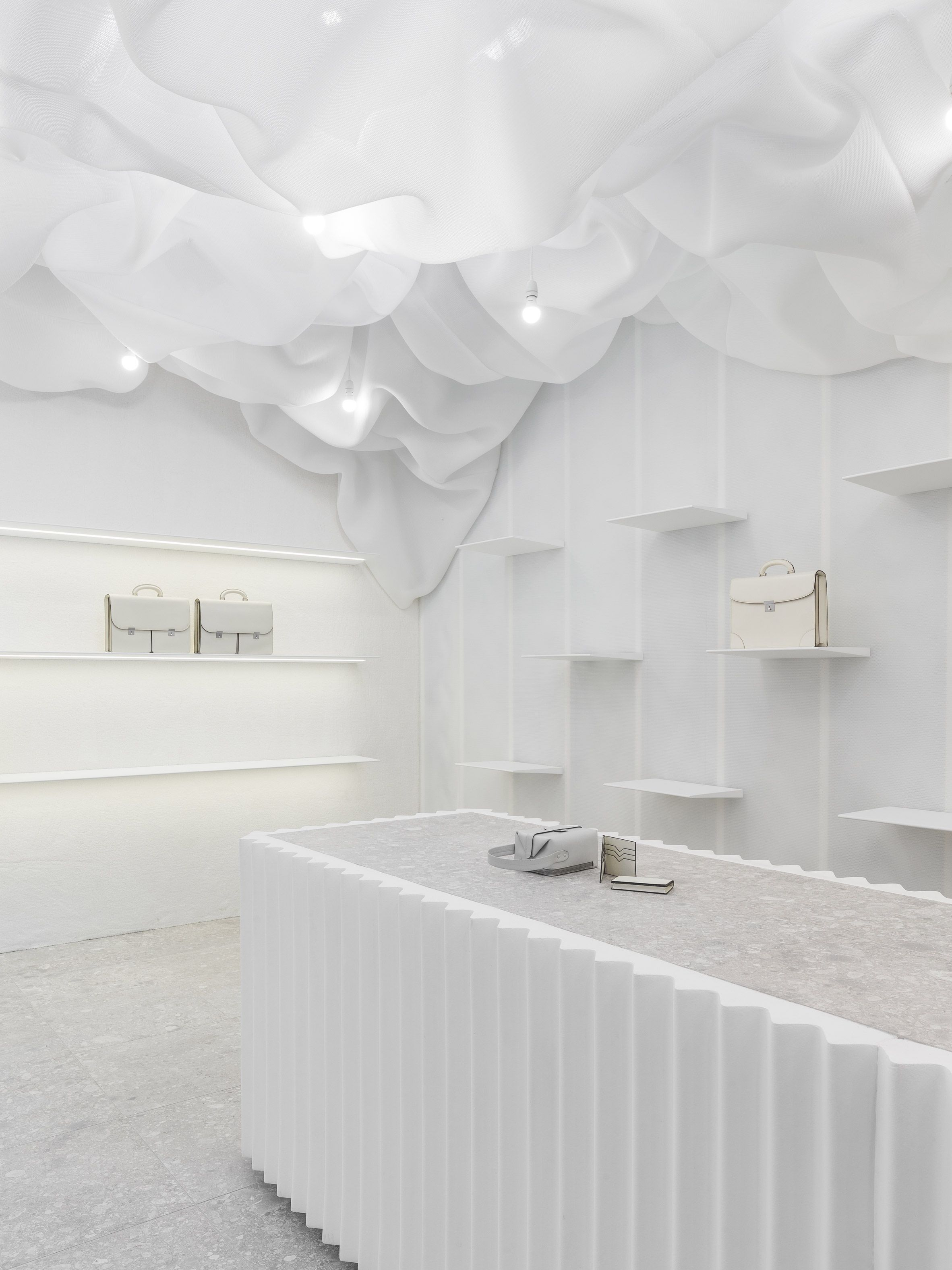 All pictures of pop design for ceiling find show all pictures of pop - Snarkitecture Creates Billowing All White Pop Up Store For Valextra In Milan Display Designstore