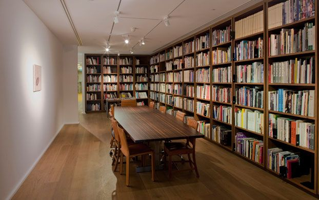 Bespoke caramelised oak shelving at Hauser & Wirth, Savile Row.