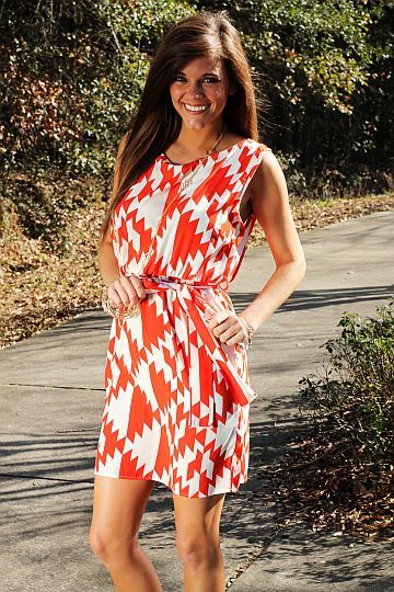 """This dress beautifully combines a classic style with a trendy pattern! We love the bold color on this piece and the deep v on the back is absolutely gorgeous. Slip on some wedges and add a bracelet or earrings for a polished looks!   Fits true to size. Miranda is wearing a small.   From shoulder to hem:  Small - 34""""  Medium - 34.5""""  Large - 35"""""""