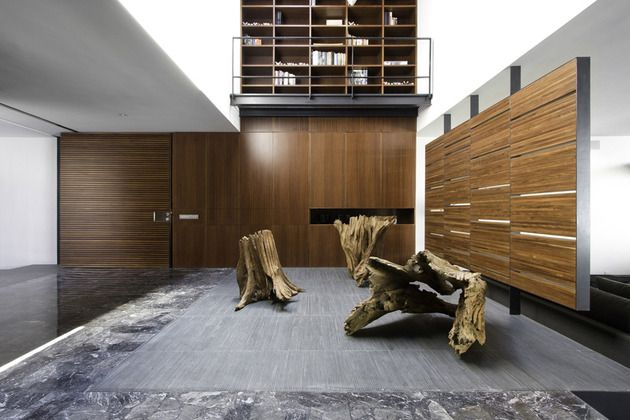 Organic interior showcases driftwood sculptures and clean lines