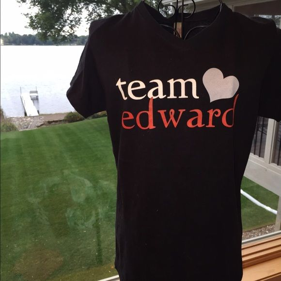 Team Edward T-Shirt - NWOT Taking it to consignment if not sold this month. Team Edward tshirt - NWOT Black v-neck tee with light blue and red writing. The back is solid black. It is a small and very slim fitting. It may be a juniors. It was a gift so I don't know where it was bought. Pre-shrunk, 100% cotton. Smoke free home ❌No trades, holds, or PayPal I'm Now On Instagram! @caligirlinmnposh Tops Tees - Short Sleeve