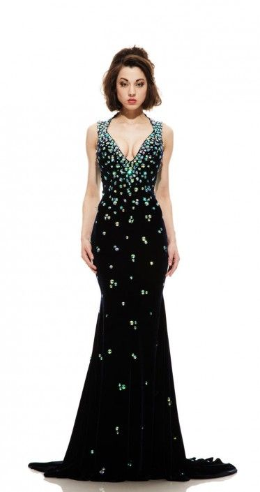 This elegant navy gown fits perfectly on the body with a deep V Queen Anne  neckline and keyhole back. 51020d0d48b94