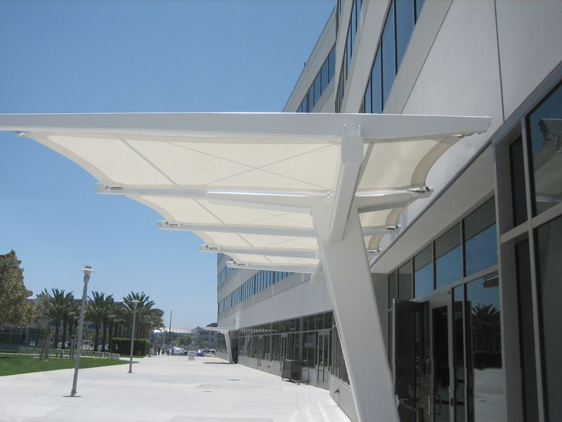 Awning canopy design entrance canopy southern for Modern building canopy design