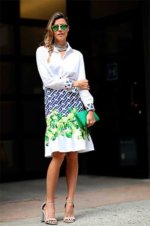White blouse and colorful skirt.