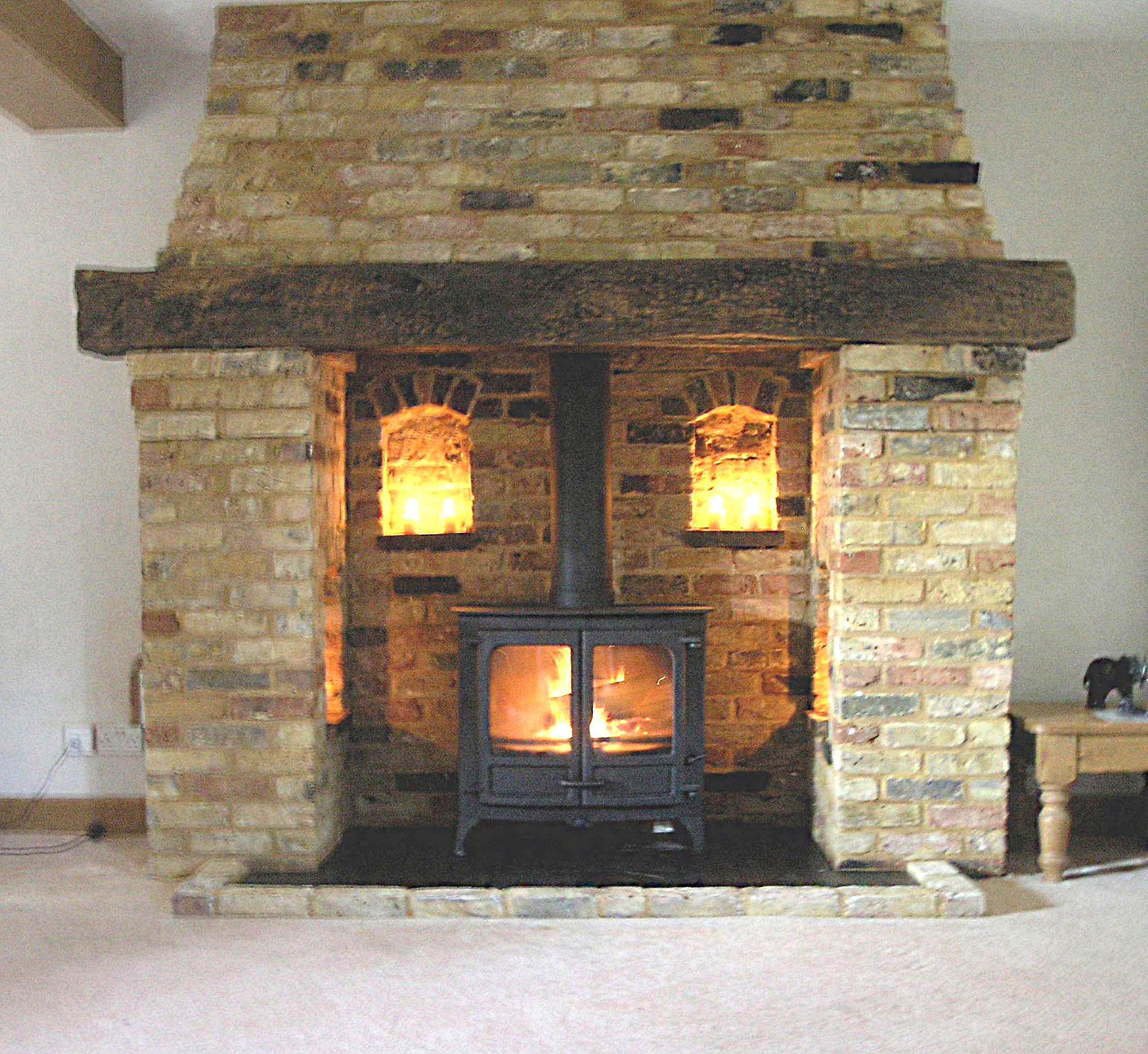 bespoke reclaimed brick and oak inglenook fireplace with a