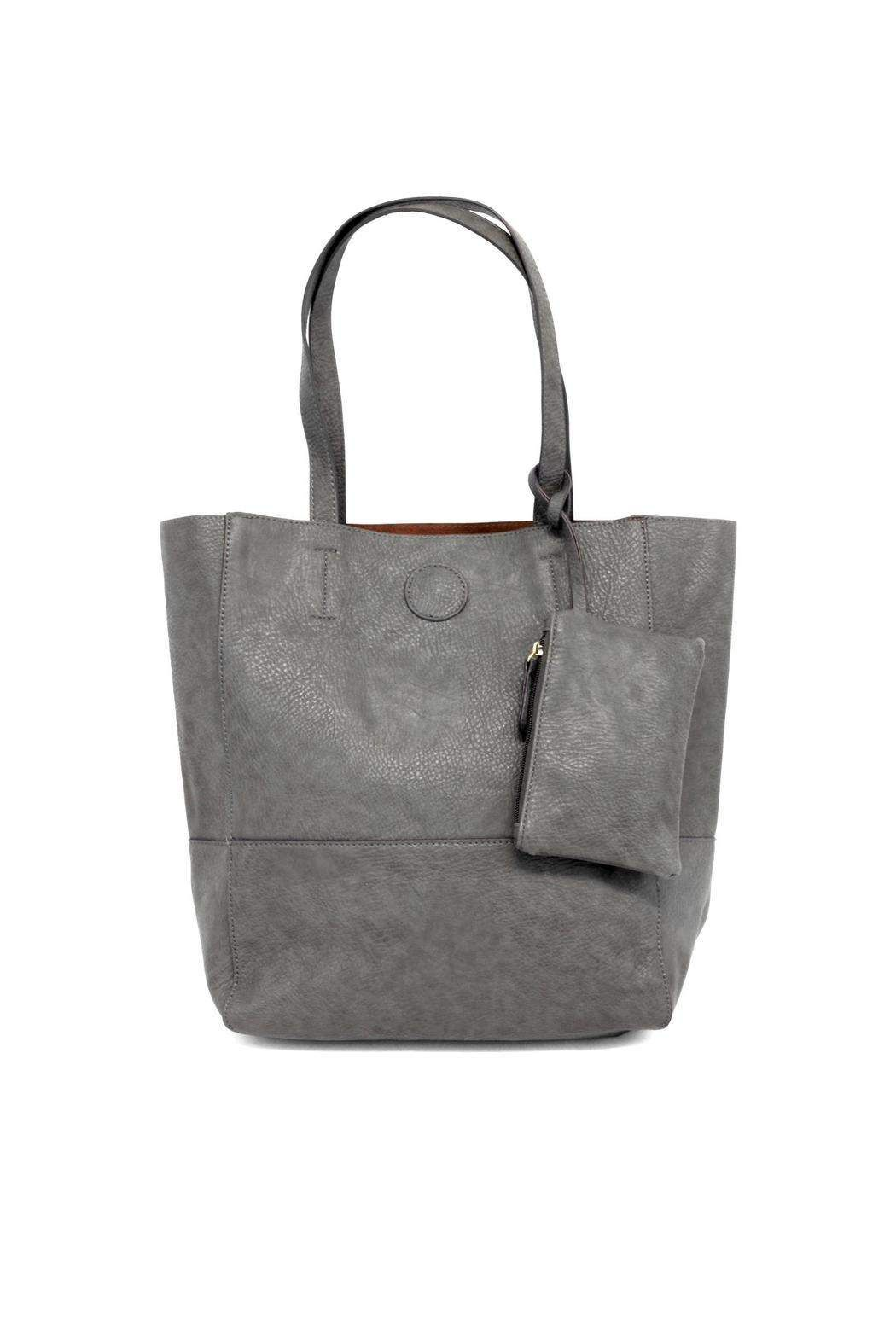 The standard raw edge tote is a remarkable handbag crafted using vegan  leather. Includes a coin purse dcd05bec3f984