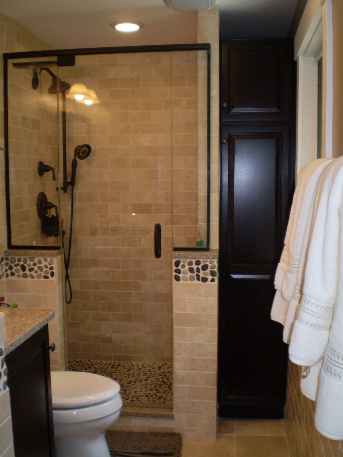 Stall shower with oil rubbed bronze framed door & fittings river