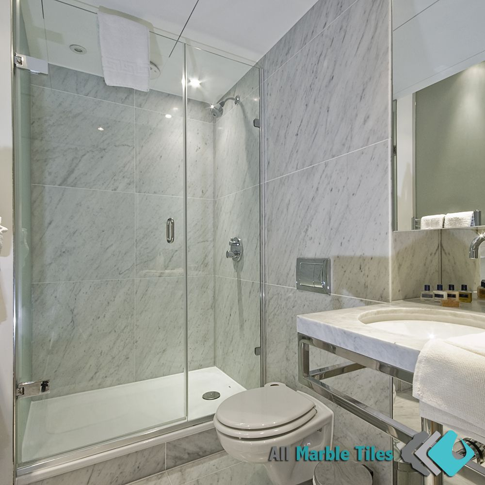 Bathroom design with bianco carrara italian marble tiles for Carrara marble bathroom floor designs