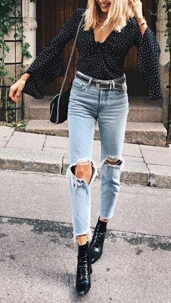 Torn jeans and a spotted blouse as inspiration