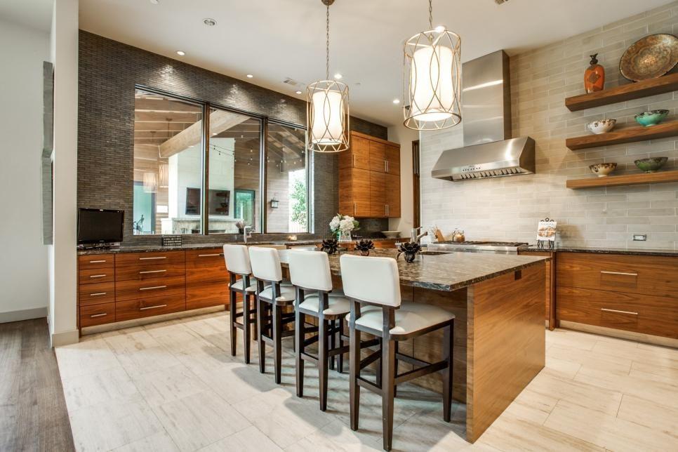 The gorgeous kitchen pairs sleek walnut cabinets with stylish ...