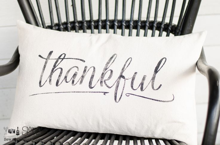 canvas pillow with the word thankful stenciled in black