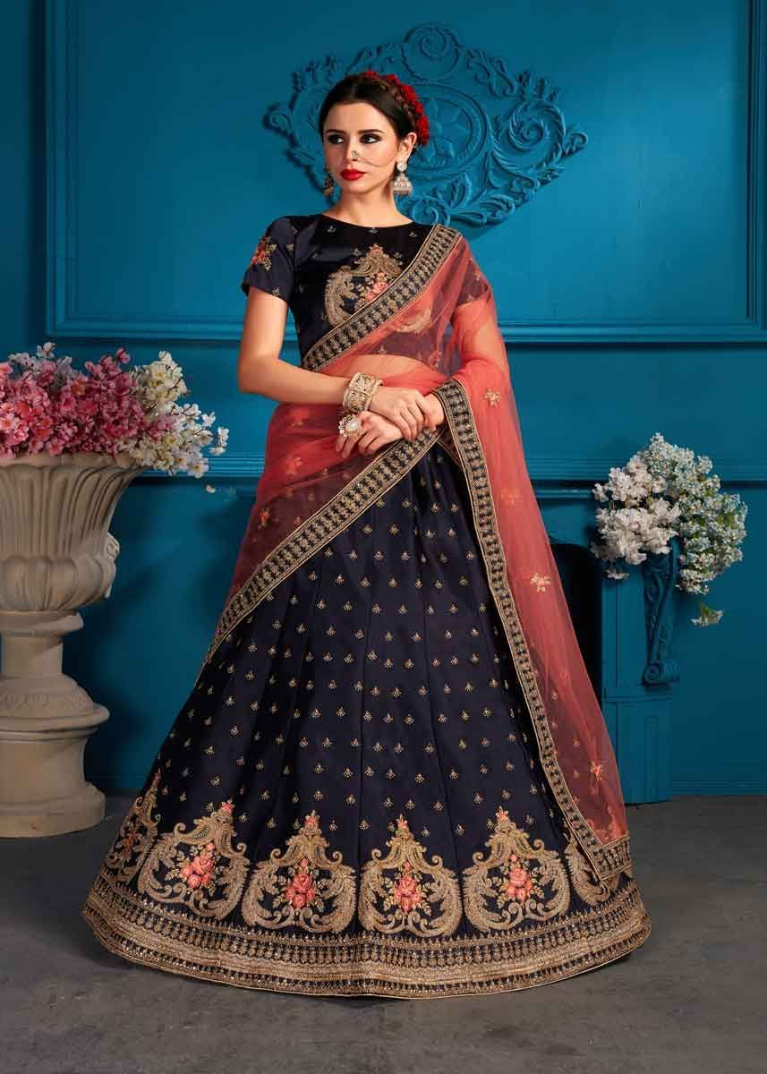 a8ca065c68 Keep warm and in style with this divine navy blue color satin embroidered  wedding wear lehenga choli. Pair this beautiful lehenga with the matching  jewelry ...