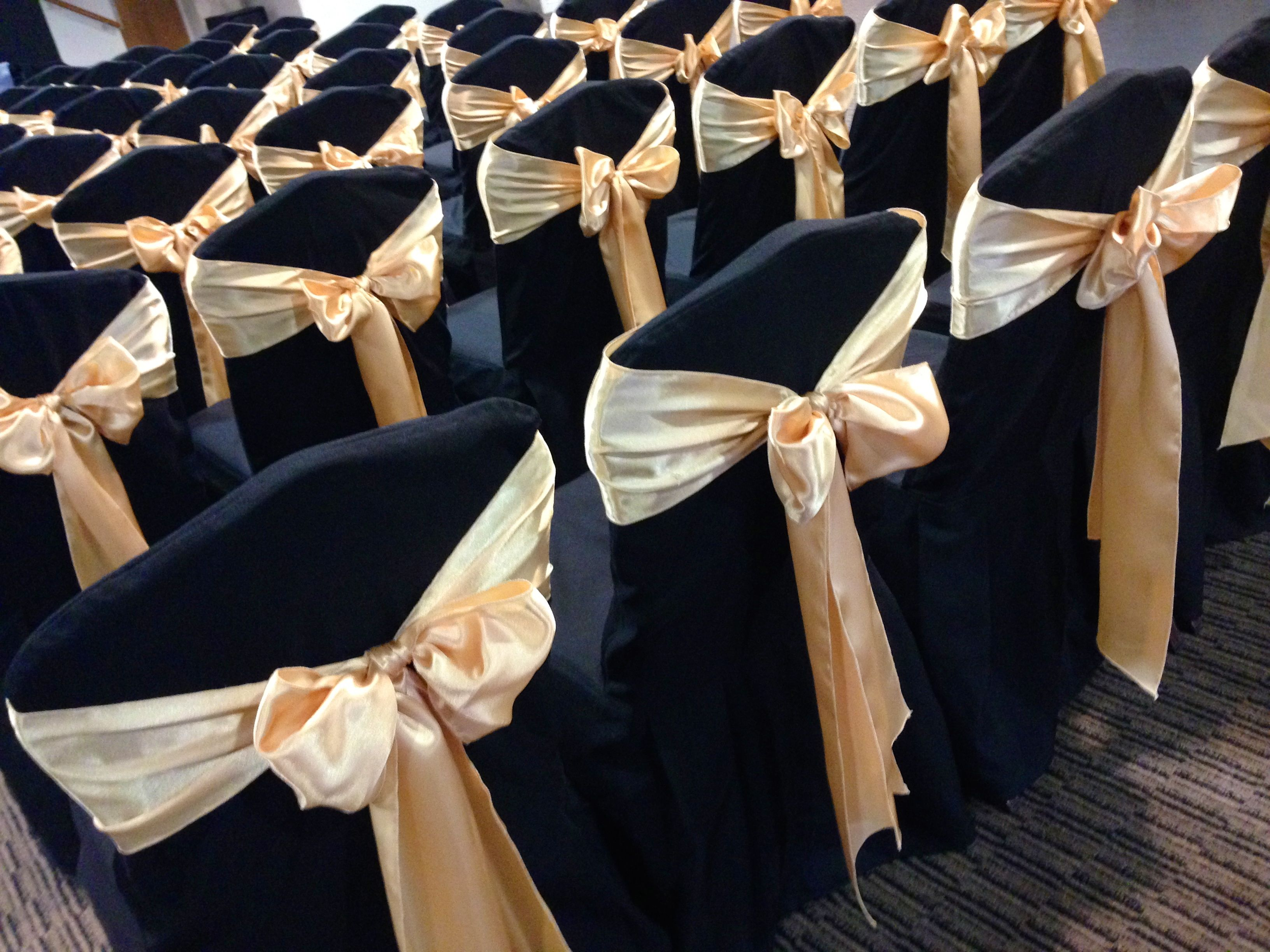 Black chair covers with rose gold sashes black chair