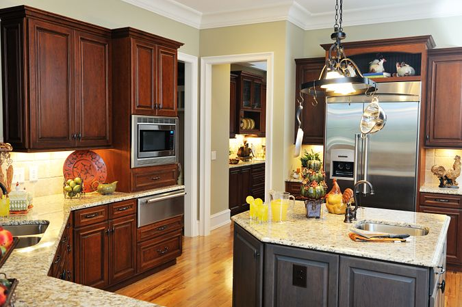 Grey Kitchen Walls With Cherry Cabinets dark cherry cabinets, gray island, nice wall color, wood flooring