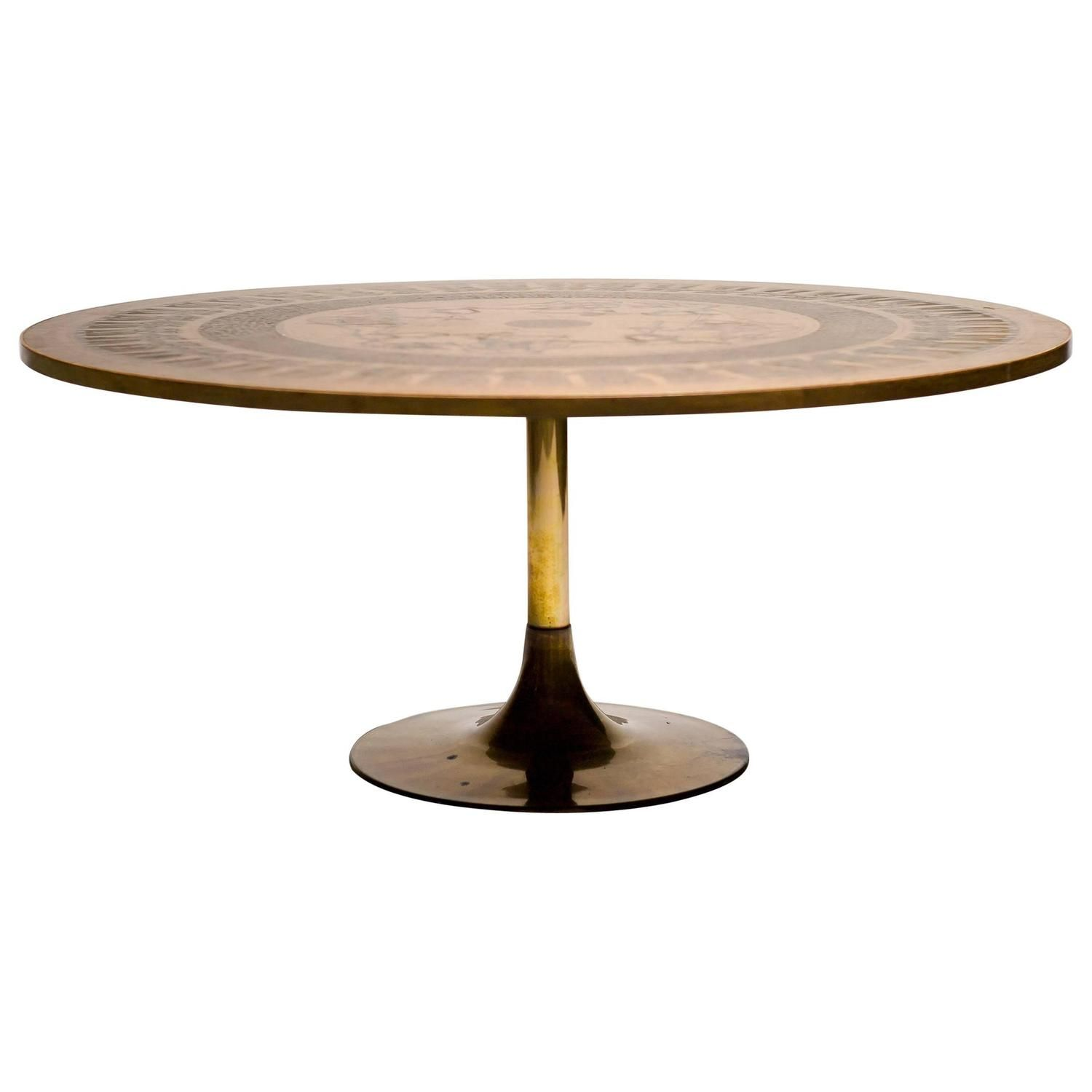 ornate coffee table with copper top consisting of a world map