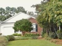 Contact Ed & Sheila Rudolph at (910) 620-7206 - http://www.rudolph.servingwilmington.com - Previous model home has open split floor plan on one level with wood floors throughout central living area. Nine foot ceilings enhance spaciousness with 3 large sets of windows providing great light. Kitchen has granite countertops, breakfast bar, & tile floor which opens onto tiled screen porch. Patio extends from porch w/ fenced back yard and greenhouse that serves dual purpose
