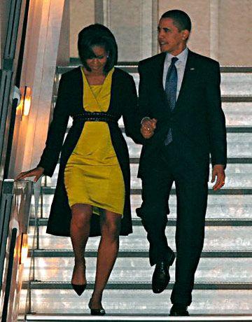 Michelle Obama Fashion in Michael Kors cardigan, dress by Jason Wu, belt by Azzedine Alaia