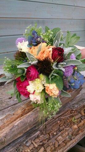 Celebration bouquets with ranunculus, cerinthe, peony, lambs ear, mint, sweet william, barley, salvia, aquilegia, ammi, allium.