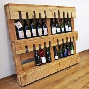 Transform an old pallet into a wine rack/bottle holder. Genious!