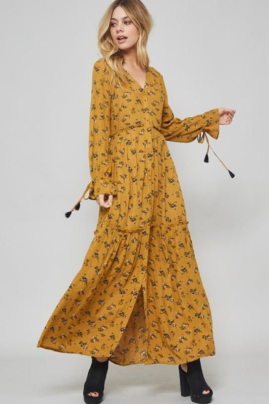 495e33640d71 A floral maxi dress featuring long sleeves with drawstring tassel ends,  plunging neckline, button front, and ruffle trim detail.