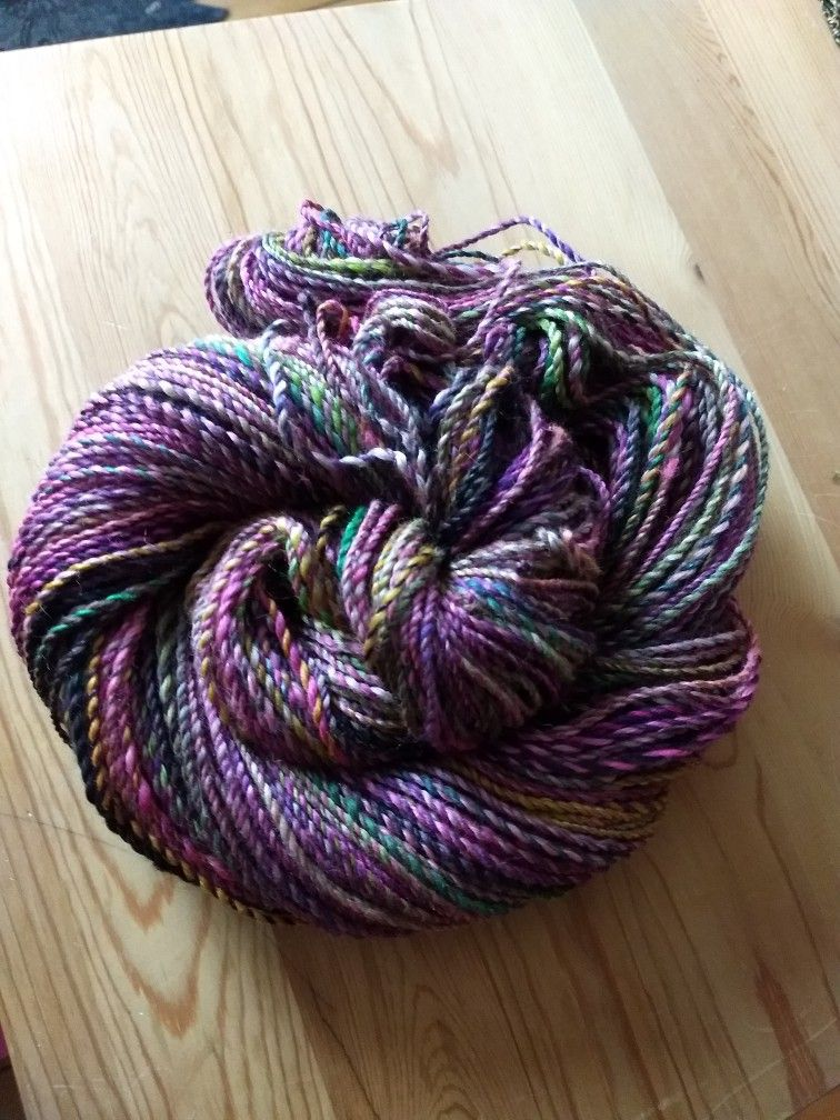 A really lively skein of handspun yarn from the great rovings of Hedgehog Fibers!! Fresh off the wheel!