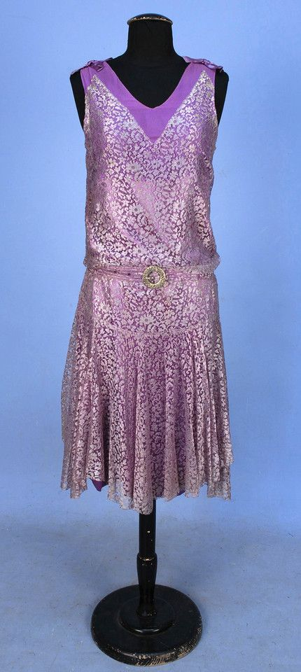 Lace Evening Dress, 1920's. Sleeveless lavender lace over lilac chiffon bodice and satin underskirt, shoulders decorated with satin bows, self belt with jeweled buckle. Front
