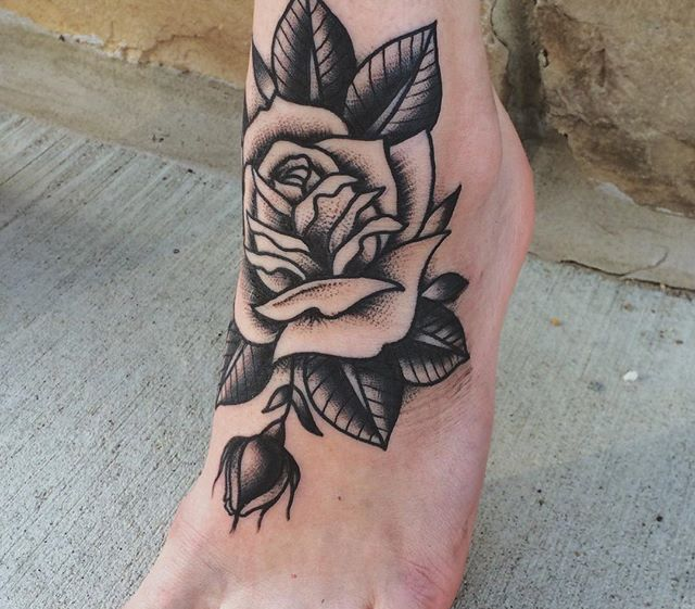 Traditional Style Black And Grey Rose Tattoo On Foot Tattoo
