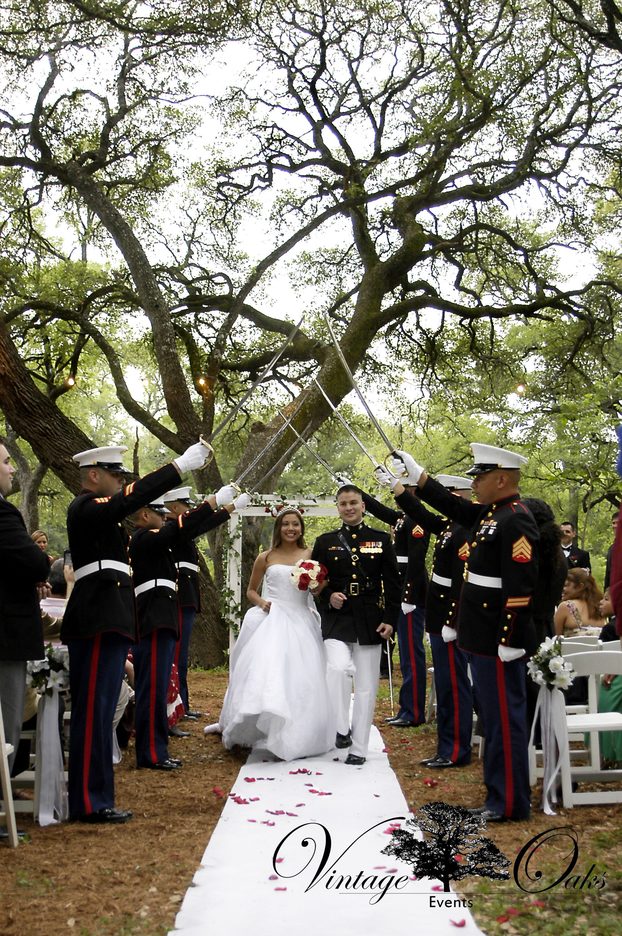 Military Wedding: Marine Corps salute the bride and groom. Outdoor wedding venue with big oak trees. www.vintageoaksevents.com