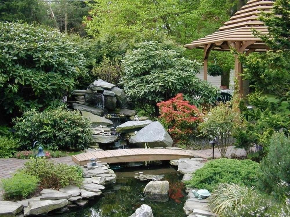 Elegance zen garden landscape design with wooden bridge for Garden pool zen area