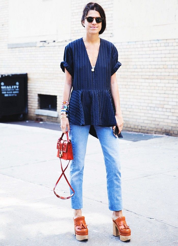 Leandra Medine in a loose v-neck peplum top, relaxed jeans and chunky mules