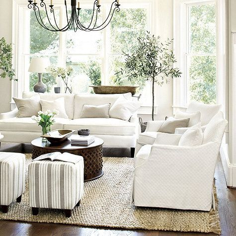 Living Room Decor Ideas   White Traditional Cottage Style, White  Slipcovered Sofas, Rustic Metal Chandelier, Striped Ottomans, Round  Metallic Coffee Table ... Design