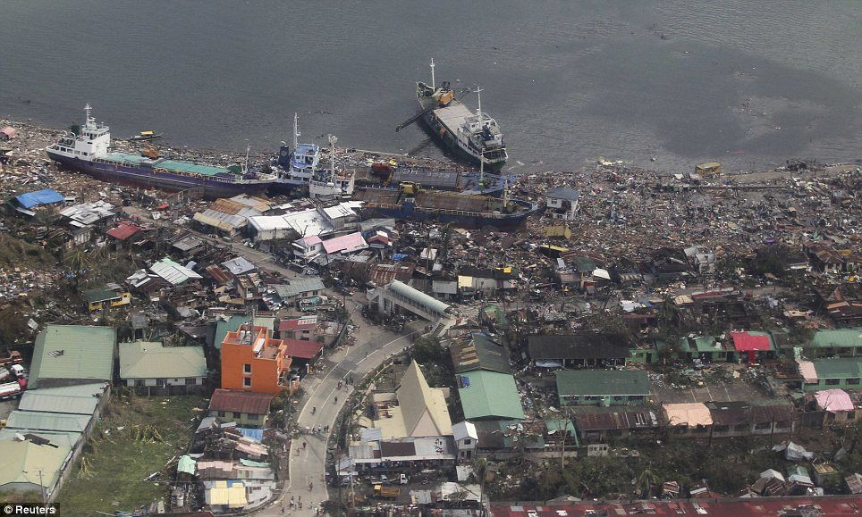 Ships that washed ashore into a coastal community after Typhoon Haiyan hit the province of Leyte in central Philippines