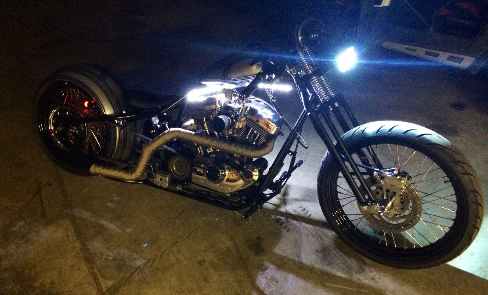 """2001 Custom 1200 Sportster Custom rigid frame, Springer front end with caliper, 250 rear tire, 18"""" rear wheel, 23"""" front wheel, LED bullet style brake lights, LED light strip under gas tank, HID 8k Headlight, Custom dual exhaust, Custom intake, Solo seat with 2"""" springs, Oil tank with all steel braided lines, Arlen ness pegs/grips, Custom paint done by JP Customs"""